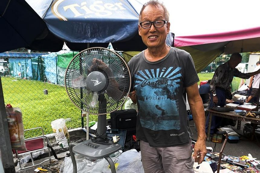 Mr Peter Chou specialises in repairing broken electric fans and selling them for a higher price at the Sungei Road flea market.