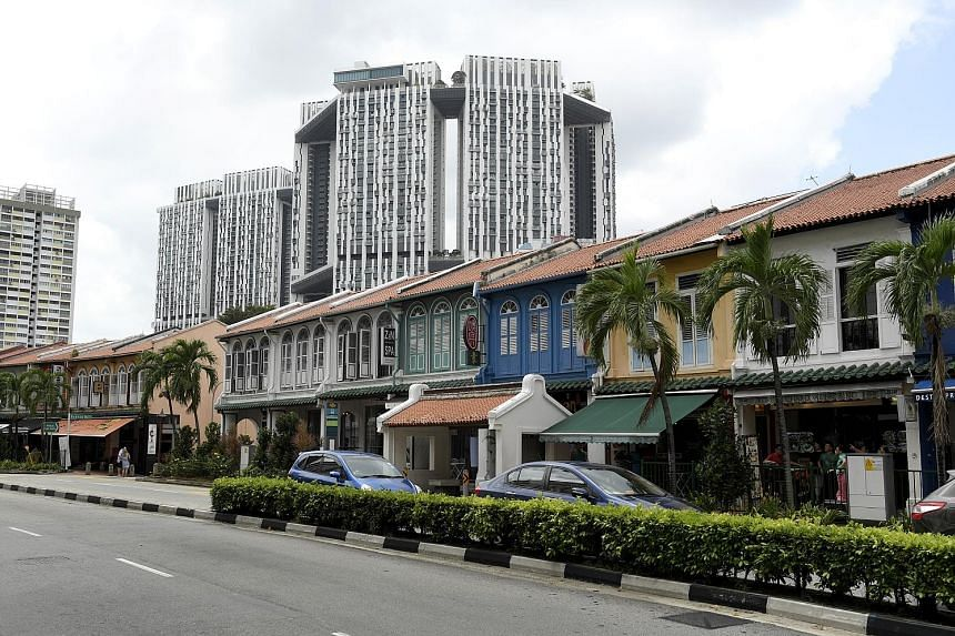 According to a South Korean working at a Korean barbecue restaurant in Tanjong Pagar Road, Mr Kim was seen in the area twice in 2014. Once, he was walking along the street (above), while the other, he was having a meal.
