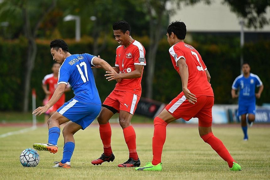 National footballer Juma'at Jantan (right) celebrated 10 years at S-League club Home United yesterday with a testimonial match at Bishan Stadium. Home took on Batch of 84, a team comprising players born in 1984, many of whom were his contemporaries a
