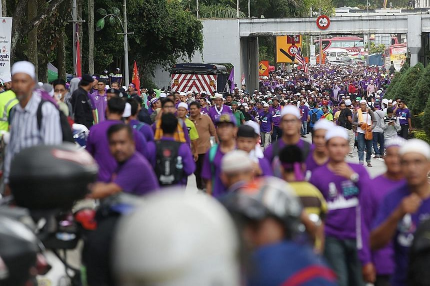Thousands in purple T-shirts gathering in Kuala Lumpur for more than eight hours yesterday to listen to speeches made by PAS leaders and Malaysia's Islamic Affairs Minister in support of stiffer Syariah Court penalties. Some Malay-Muslims are themsel