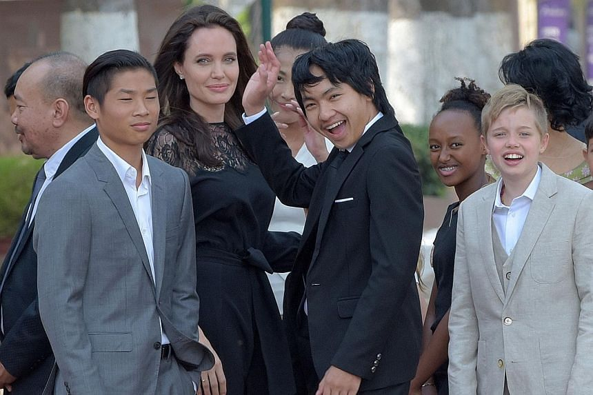 Jolie, the director of First They Killed My Father, with her children in Cambodia, a country she shares a deep affinity with through her adopted son Maddox (centre).