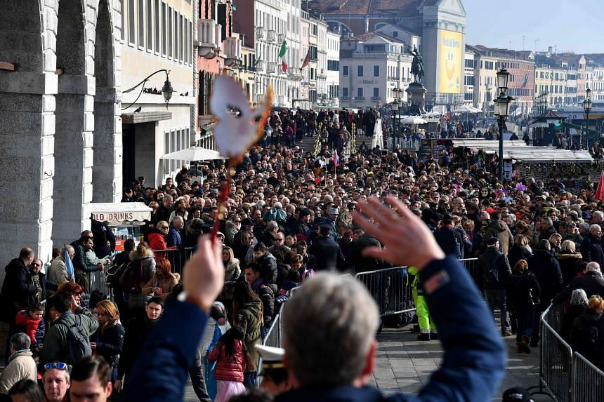 Crowds packing St Mark's Square in Venice as they wait for the Flight of the Angel, on Feb 19, 2017.