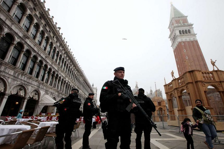 Italian Carabinieri officers patrolling St Mark's Square during the Venice Carnival on Feb 17, 2017.