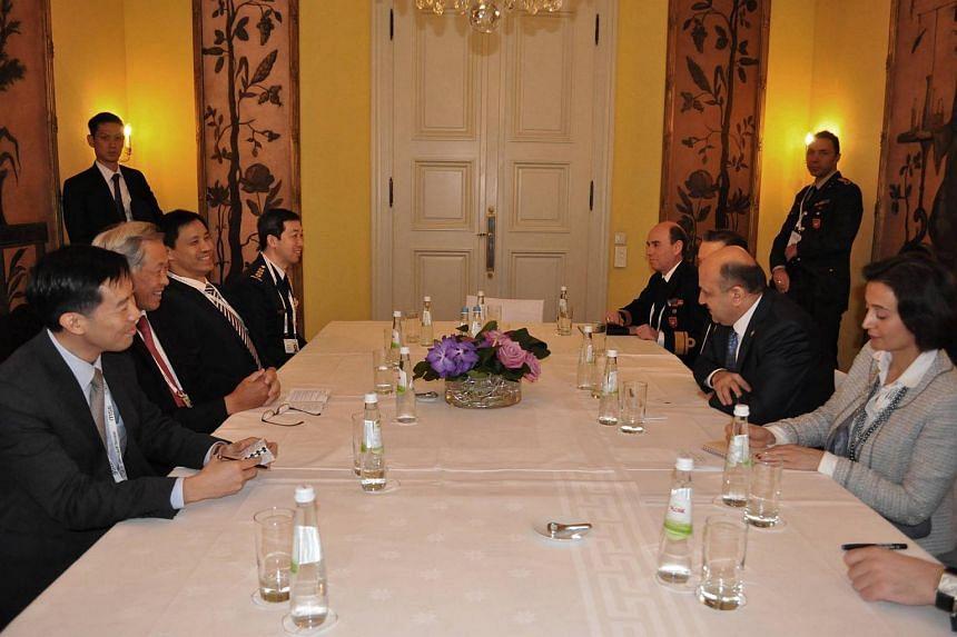 Defence Minister Ng Eng Hen opposite Turkish Defence Minister Fikri Isik.