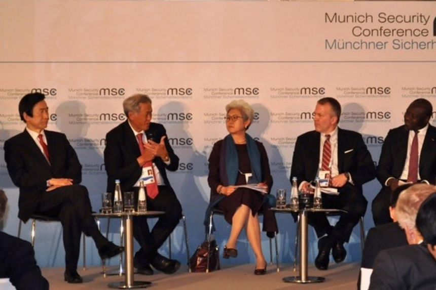Defence Minister Ng Eng Hen (second from left) addressing the 53rd Munich Security Conference during his speech.