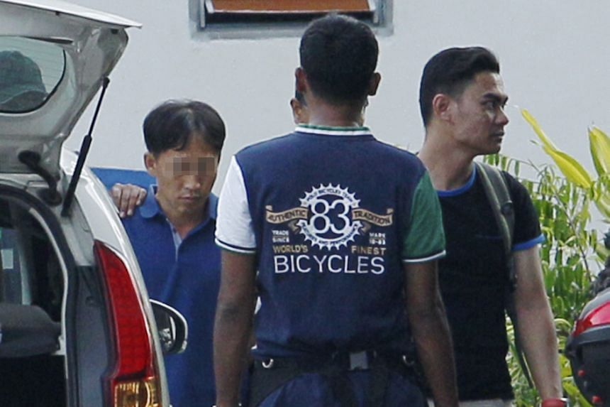 North Korean Ri Jong Chol, who was arrested in connection with the death of Mr Kim, under heavy guard at the police headquarters in Sepang yesterday.
