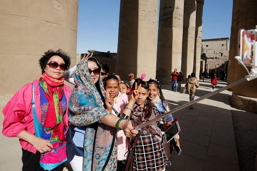 Tourists taking a selfie at the Luxor temple in the port city of Luxor, south of Cairo, Egypt, on Dec 14, 2016.