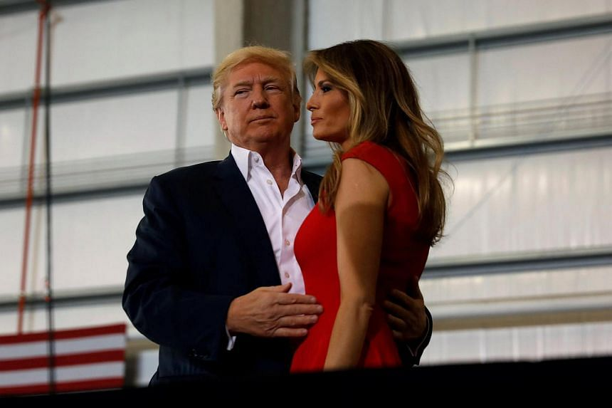 "US President Donald Trump hugs his wife Melania during a ""Make America Great Again"" rally at Orlando Melbourne International Airport in Melbourne, Florida, US on Feb 18, 2017."