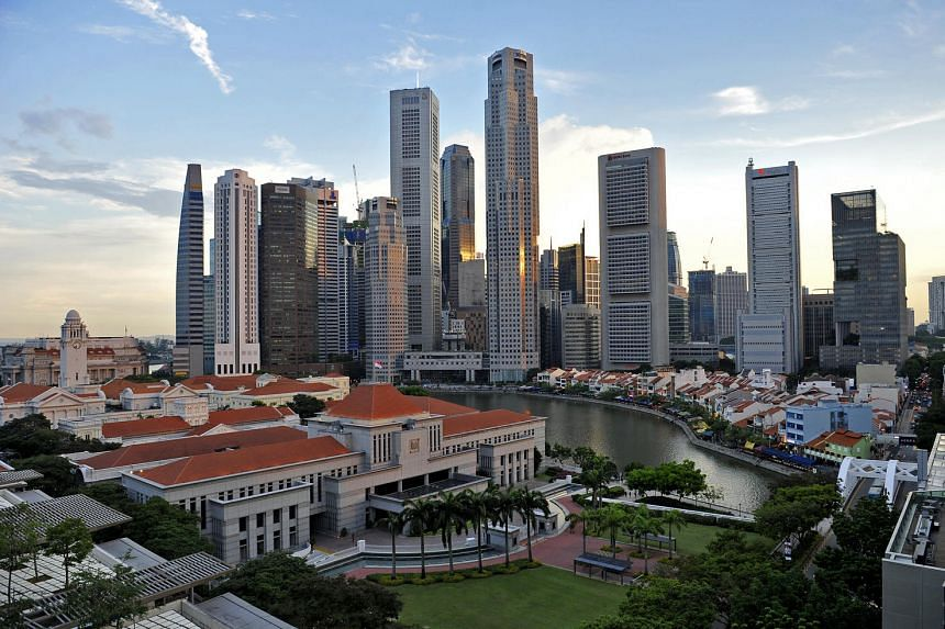 A bird's eye view from the rooftop of the Treasury of Parliament House, Boat Quay, Singapore River and the Singapore financial district.