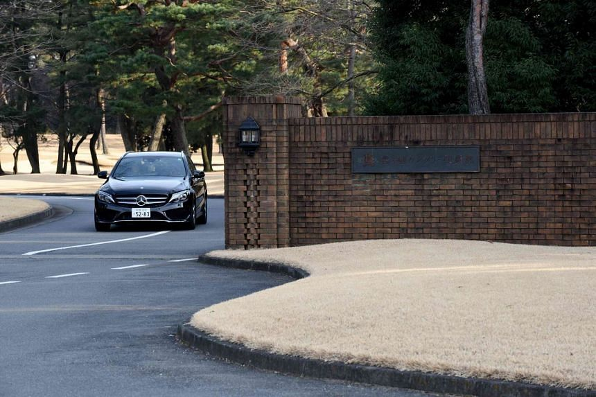 A car leaves the main entrance of the Kasumigaseki Country Club in Kawagoe, suburb of Tokyo on Jan 18, 2017.