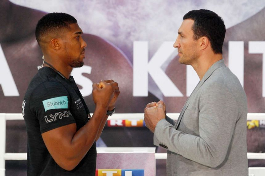British boxer Anthony Joshua (left) and Wladimir Klitschko of the Ukraine at a press conference in Cologne, Germany, on Feb 16, 2017.