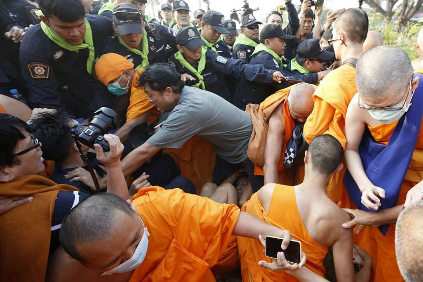Thai Buddhist monks of Dhammakaya Temple and their supporters scuffling with police officers outside the temple in Pathum Thani province, on the outskirts of Bangkok, Thailand, on Feb 20, 2017.