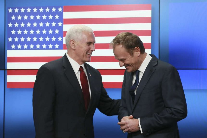 US Vice President Mike Pence (left) being welcomed by European Council President Donald Tusk prior to their meeting in Brussels, Belgium, on Feb 20, 2017.