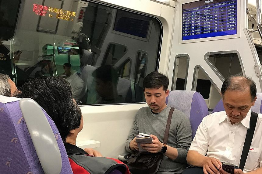 Commuters trying out the express train service from Taoyuan Airport Terminal 2 before its official launch on March 2. The 35-minute direct train ride from the airport to Taipei Main Station in the city costs $7.40.