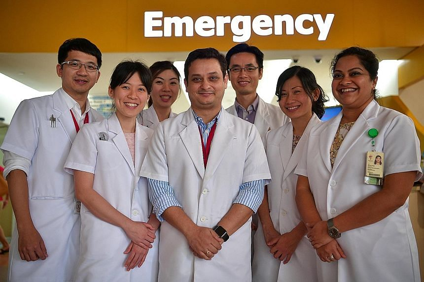 Physiotherapists (from far left) Ringo Yee, Ong Pei Gin, Christina Chia, Gadru Rahul, Jason Loh, Tee Lee Huan and Sharika Udipi are put on standby to treat patients at TTSH's A&E department. Over 900 patients at the hospital were treated under this p