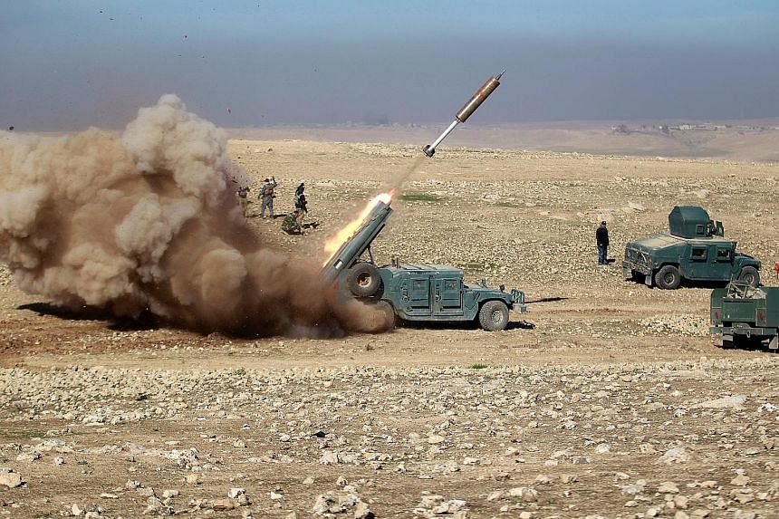 Members of the Iraqi rapid response forces firing a missile at an ISIS target during a battle south of Mosul yesterday. Iraqi federal police units are leading a northward charge on the Mosul districts that lie west of the Tigris river, aiming to capt