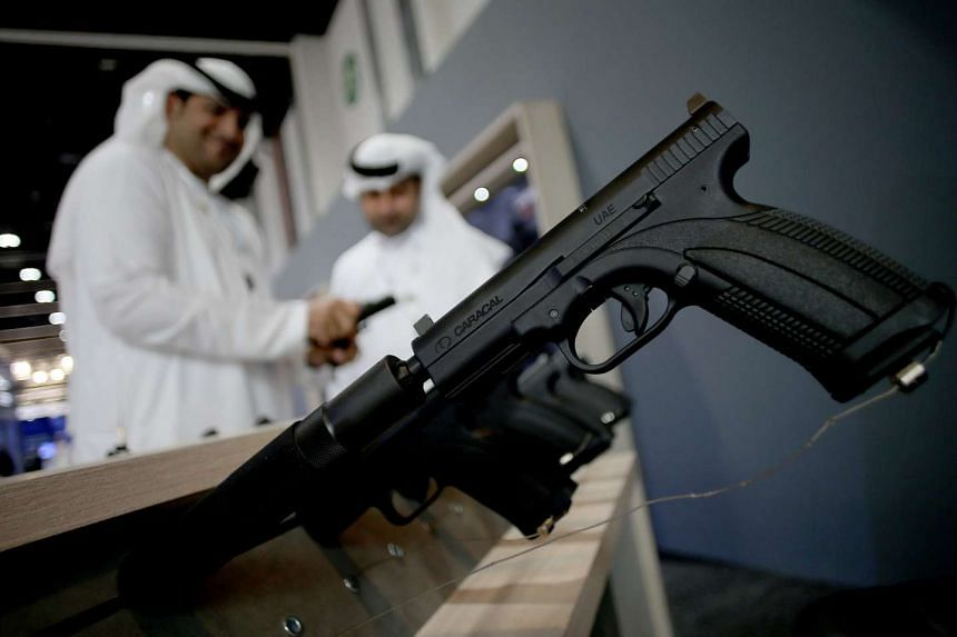 Handguns are seen on the first day of the International Defence Exhibition and Conference IDEX in Abu Dhabi on Feb 19, 2017.
