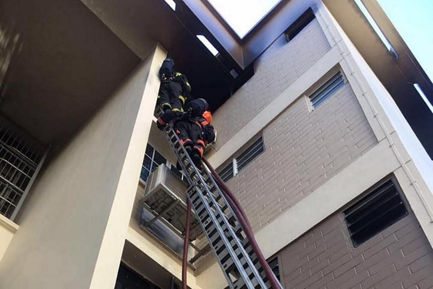SCDF firefighters pitched a ladder to rescue the man, who was spotted on the fourth-storey ledge outside his bedroom.