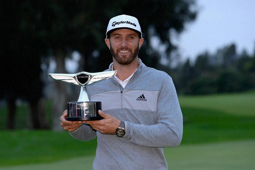 Dustin Johnson poses with the trophy during the final round at the Genesis Open at Riviera Country Club, on Feb 19, 2017.