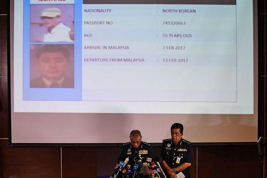 Royal Malaysian Police deputy inspector-general Noor Rashid Ibrahim (left) speaking about North Korean suspect O Jong Gil (top) during a press conference as Selangor state police chief Abdul Samah Mat  looks on, at the Bukit Aman national police head