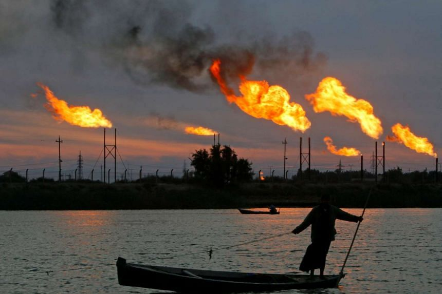 Flame emerges from flare stacks at the oil fields in Basra, Iraq, on Jan 17, 2017.