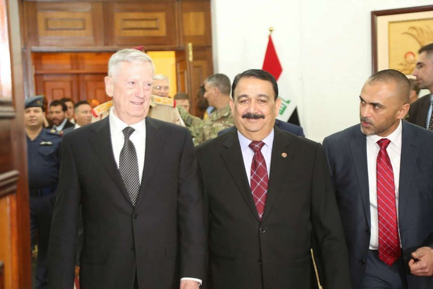 US Defence Secretary Jim Mattis (left) walks with Iraq's Defence Minister Erfan al-Hiyali (centre) at the Ministry of Defence in Baghdad on Monday (Feb 20, 2017).