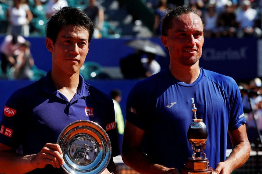 Winner Alexandr Dolgopolov of Ukraine (right) and runner-up Kei Nishikori of Japan pose with their trophies.