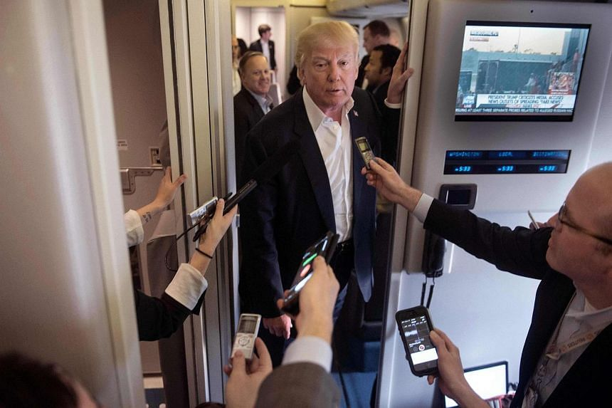 US President Donald Trump speaking to the press aboard Air Force One before addressing a rally in Melbourne, Florida, on Feb 18, 2017.