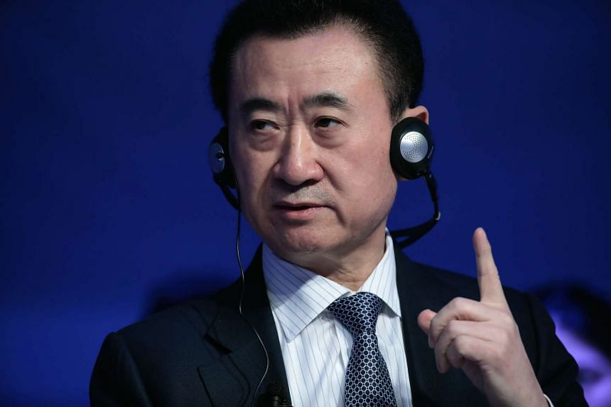 Wang Jianlin, billionaire and chairman and president of Dalian Wanda Group Co., gestures as he speaks during a panel session at the World Economic Forum in Davos, Switzerland, on Jan 18, 2017.