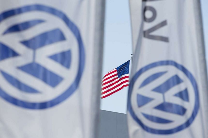 An American flag flies next to a Volkswagen car dealership in San Diego, California, US on Sept 23, 2015.