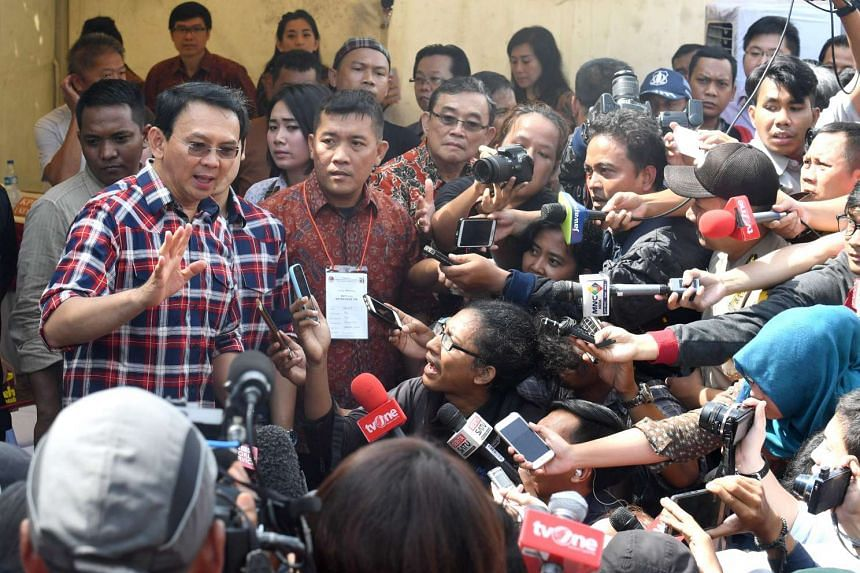"""Jakarta's governor Basuki Tjahaja Purnama or better known as """"Ahok"""", talking to the media after he casts his vote in Jakarta, on Feb 15, 2017."""