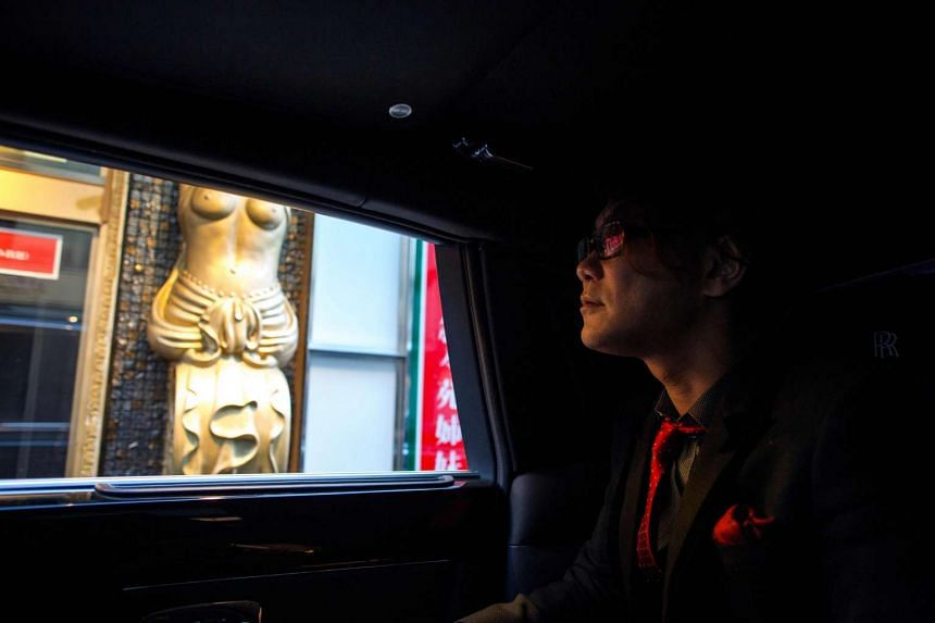 43-year-old former host Sho Takami, who owns a chain of host clubs, arrives in his Rolls Royce to his club in the Kabukicho red-light district in Tokyo.