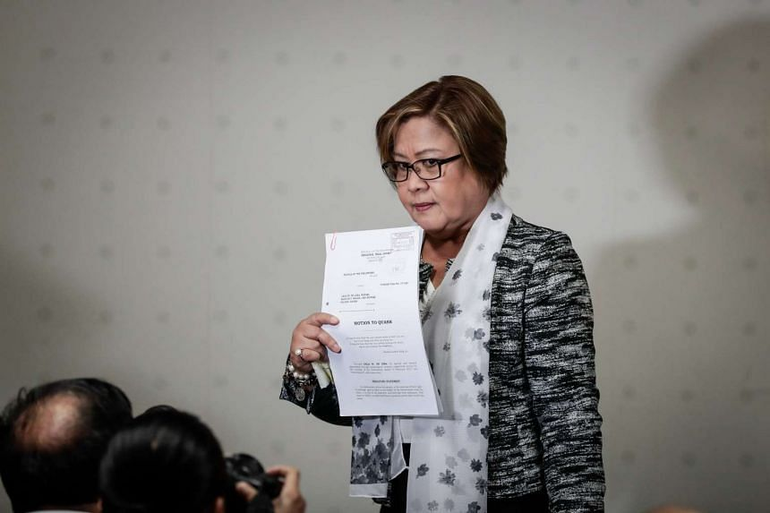 Philippine Senator Leila De Lima shows documents petitioning the dismissal of charges against her after a press conference at the Philippine Senate in Pasay City, south of Manila, Philippines, Feb 21, 2017.