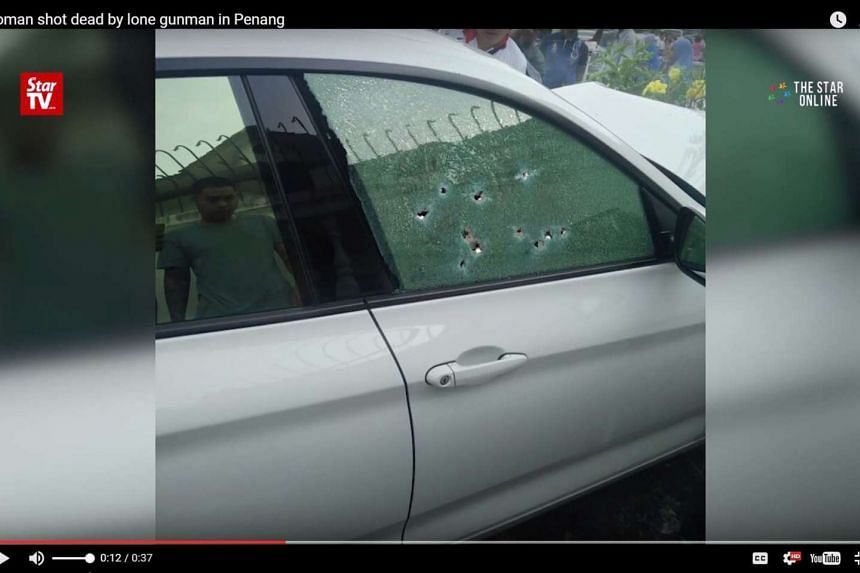 Several bullet holes were found on the window of her car.