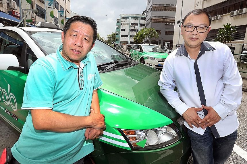 HDT cabbies Michael Ng (far left) and Danny Chia get a basic gross income of $1,900 a month, including CPF contributions.