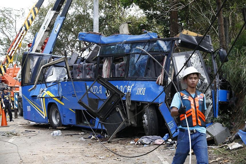 Fourteen college students on a camping trip were killed and dozens injured yesterday when their bus slammed into an electricity post in a mountainous area of the Philippines, police said. The bus was taking more than 50 teenage students and an instru