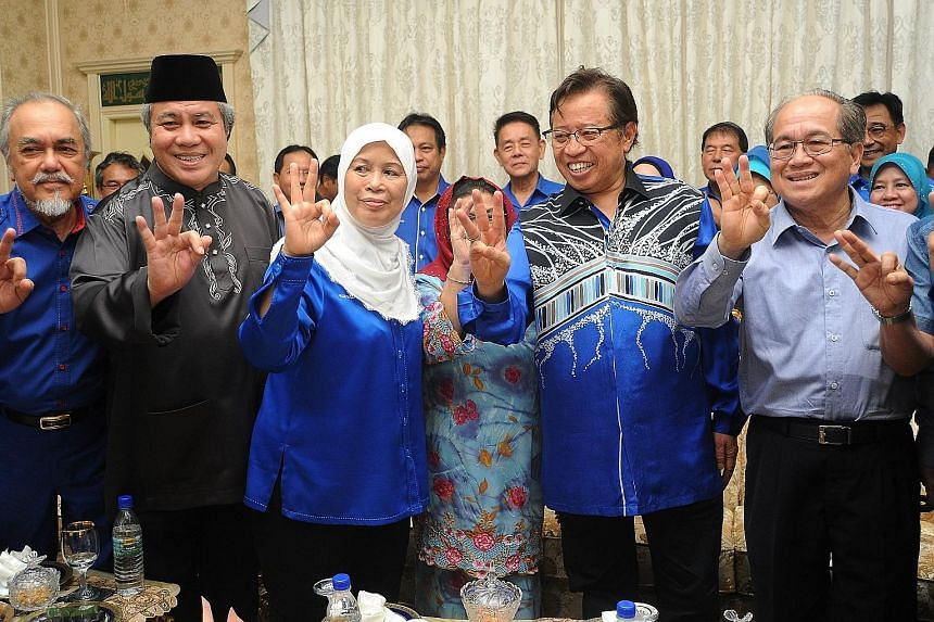 Ms Jamilah celebrating her landslide victory in the Tanjung Datu by-election with Sarawak Chief Minister Abang Johari Tun Openg (second from right) and other BN members last Saturday.
