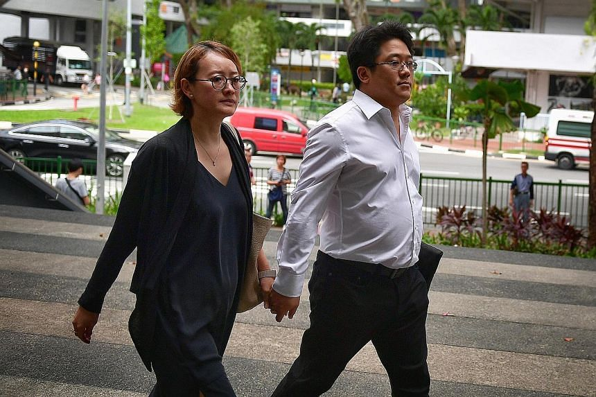 Ong Jenn arriving at the State Courts yesterday with his wife. He is on trial for two counts of engaging in a conspiracy with Mohamad Ismail to traffic cannabis.