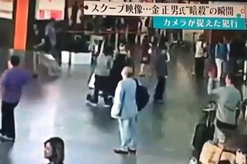 An image from CCTV camera footage showing Mr Kim (centre) checking flight schedules at Kuala Lumpur International Airport 2 on Feb 13. A woman in white is seen behind Mr Kim, throwing something over his head and locking her arms around him briefly. M