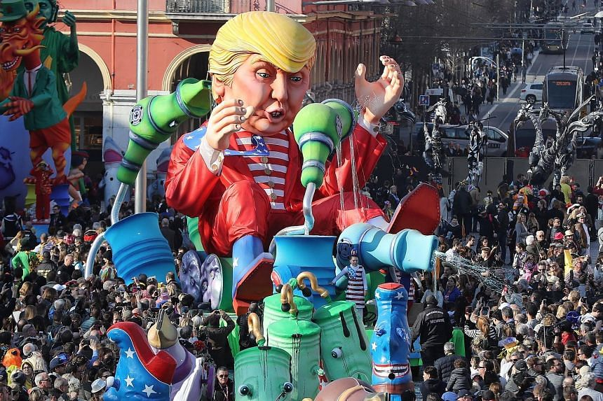 """A Donald Trump """"Wind of Change"""" float at a parade during the Nice carnival in France over the weekend. Economists are watching the US' use of government data as President Trump bids to promote his economic policies. He and his advisers see the US goo"""