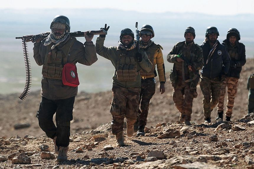 Iraqi forces, supported by paramilitaries, advancing near the village of Sheikh Younis, south of Mosul, after the offensive to retake the western side of the city from ISIS on Sunday. US Defence Secretary Mr Mattis said US Special Forces will not get