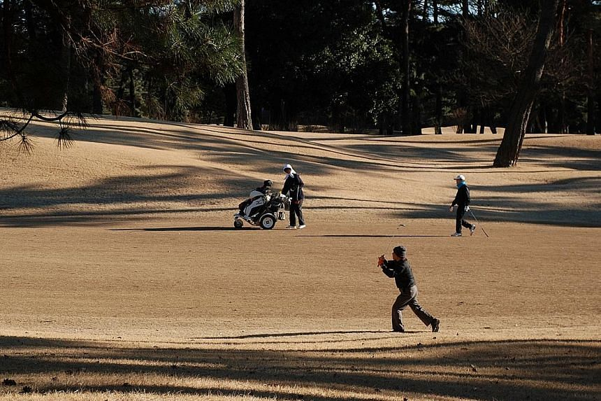 Golfers in action at Kasumigaseki Country Club last month. Women cannot play there on Sundays and are not allowed as full members. International Olympic Committee vice-president John Coates has made it clear the organisers would find another venue fo