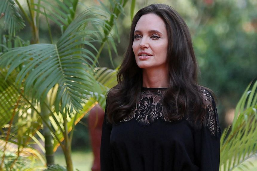 Actress Angelina Jolie arrives for a news conference at a hotel in Siem Reap province, Cambodia, on Feb 18, 2017.