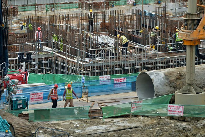 Workers at the construction site near the Singapore Post Centre at Eunos.