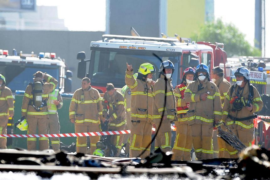 Fire crew at the scene where a light plane crashed into the back of a building at Essendon airport in Melbourne, Australia, on Feb 21, 2017.