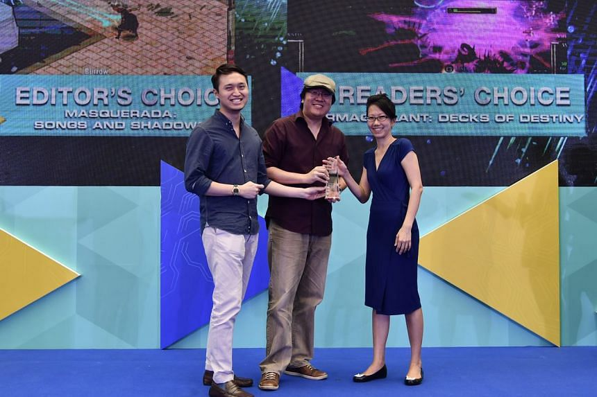 (From left) Mr Brian Kwek, executive producer, and Mr Ian Gregory Tan, creative director, both from Witching Hour Studios, receiving the award for the best local game (Editor's Choice: Masquerada: Songs and Shadows) from ST Tech Editor Irene Tham, du