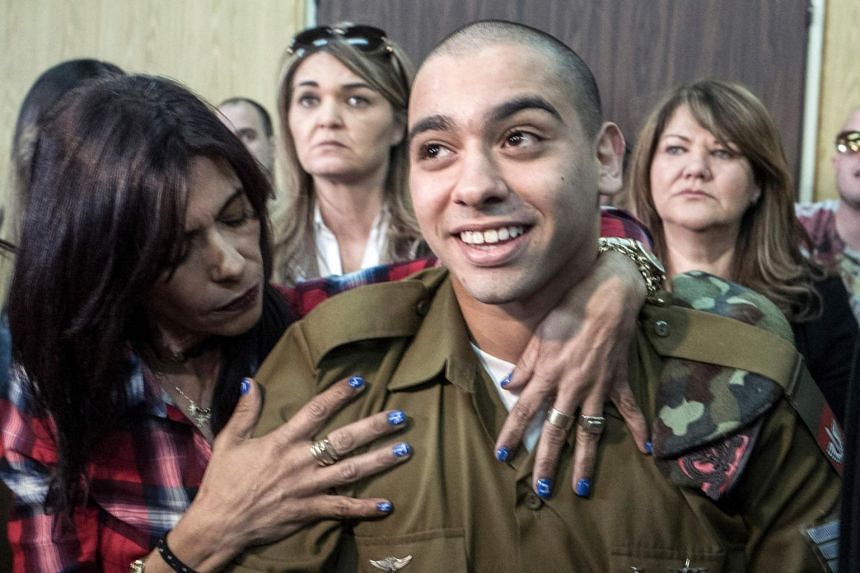 Israeli soldier Elor Azaria being hugged by his mother at the start of his sentencing hearing in Tel Aviv on Feb 21, 2017.