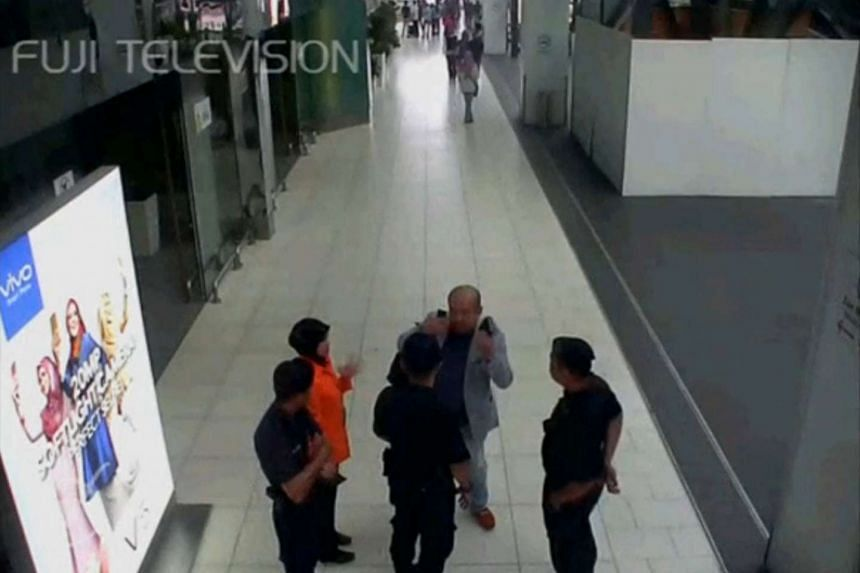 A still image from CCTV footage showing a man purported to be Kim Jong Nam speaking with airport security personnel at Kuala Lumpur International Airport on Feb 13, 2017.