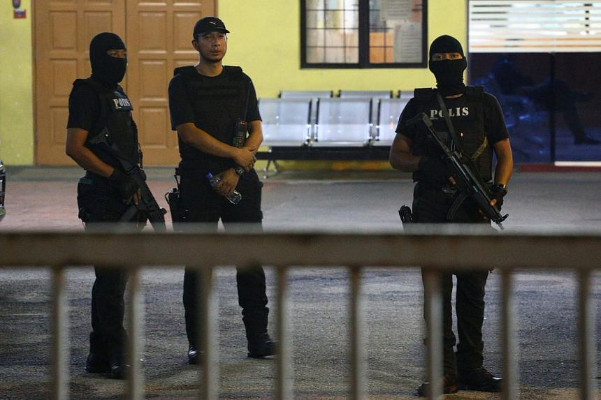 Members of the Royal Malaysia Police special operation forces standing guard at the gate of the morgue at Kuala Lumpur General Hospital where Kim Jong Nam's body is held for autopsy in Malaysia, on Feb 21, 2017.