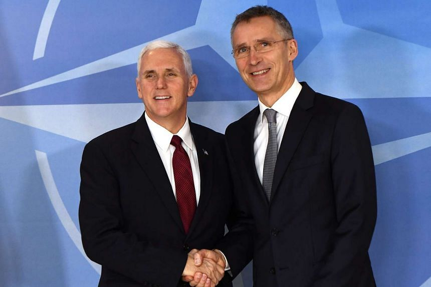 US Vice-President Mike Pence (left) shakes hands with NATO Secretray General Jens Stoltenberg at NATO headquarters in Brussels on Monday (Feb 20, 2017).